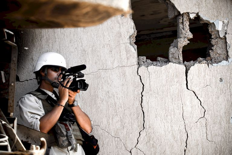 SIRTE, LIBYA - Journalist Jim Foley films Libyan NTC fighters attacking Colonel Gaddafi's home city of Sirte in October 2011.