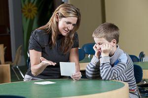teacher with student teaching letter blends