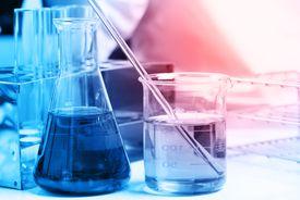 Blue liquids in chemistry glassware