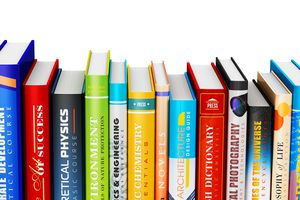 row of textbooks on white background
