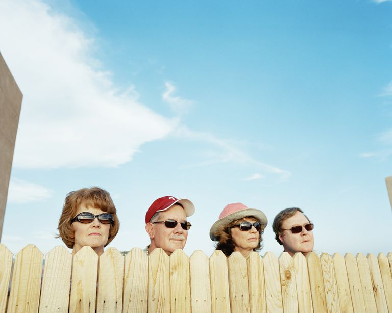 Group of people looking over fence