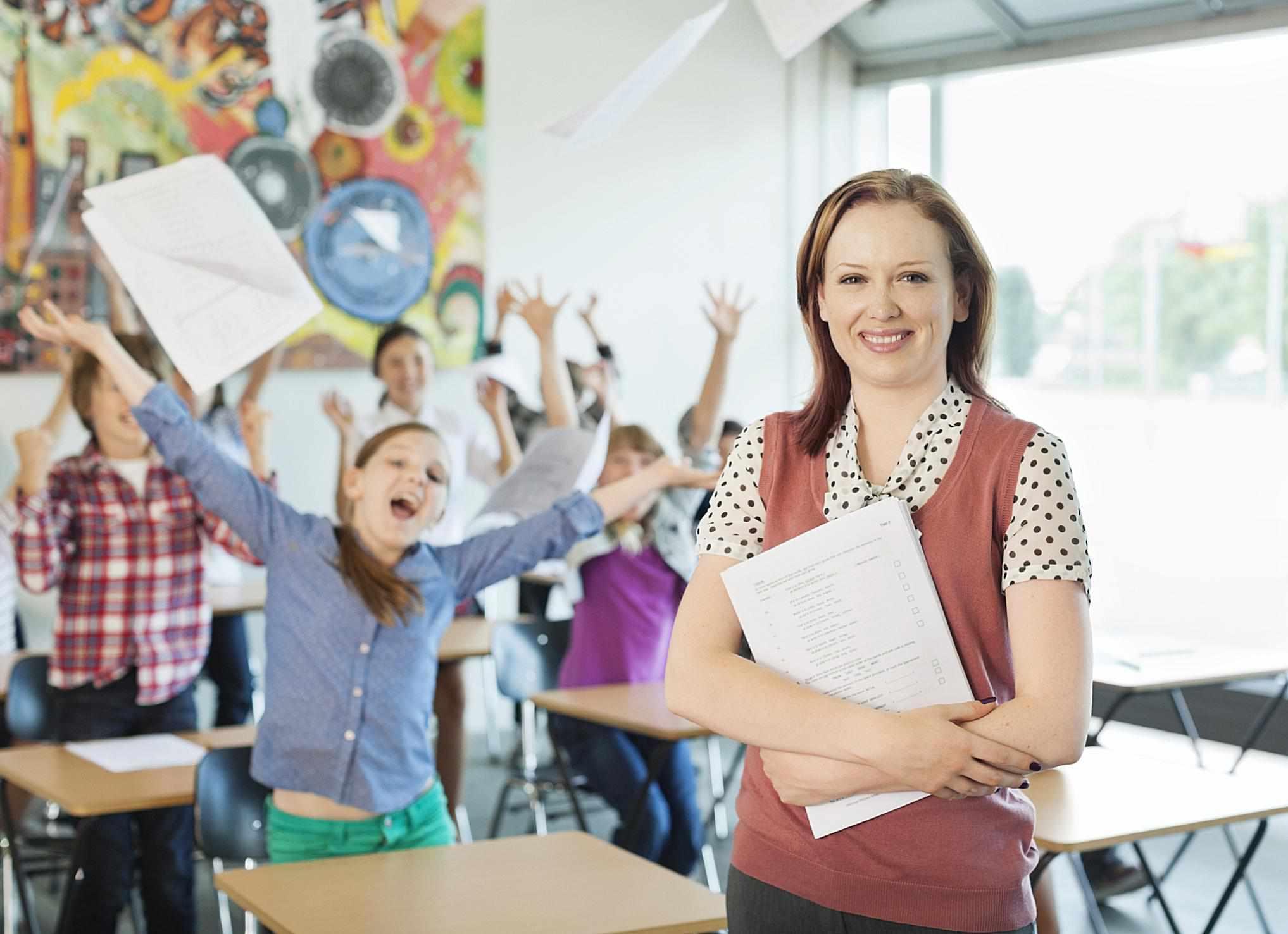 A teacher in front of screaming children