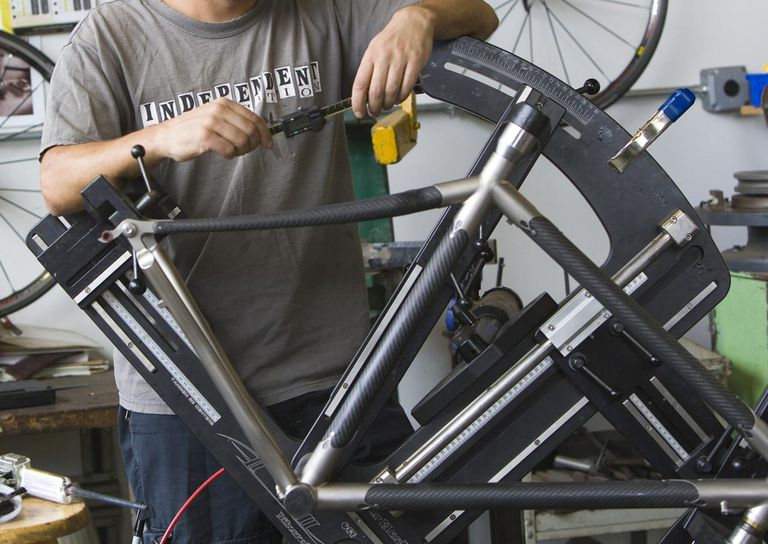 Man, 41 years old, assembling a carbon fiber bike frame