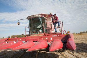 Iowa farmer standing on his harvester