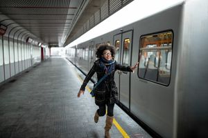 Woman is late for a train and trying to catch it