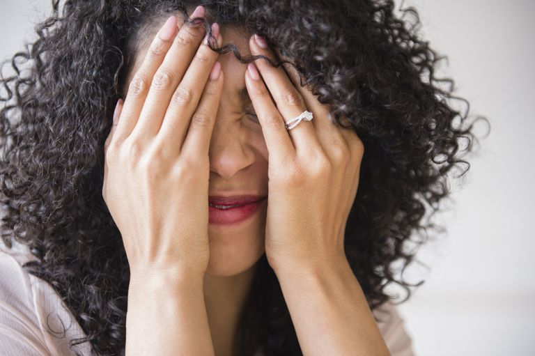 Woman covering her face in embarrassment
