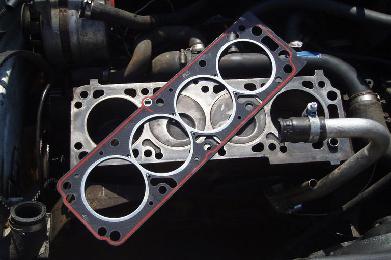 new composite head gasket ready to be installed on a four cylinder engine block