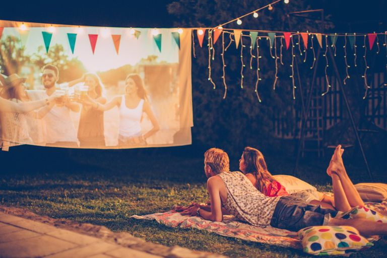 A couple watching a movie outdoors