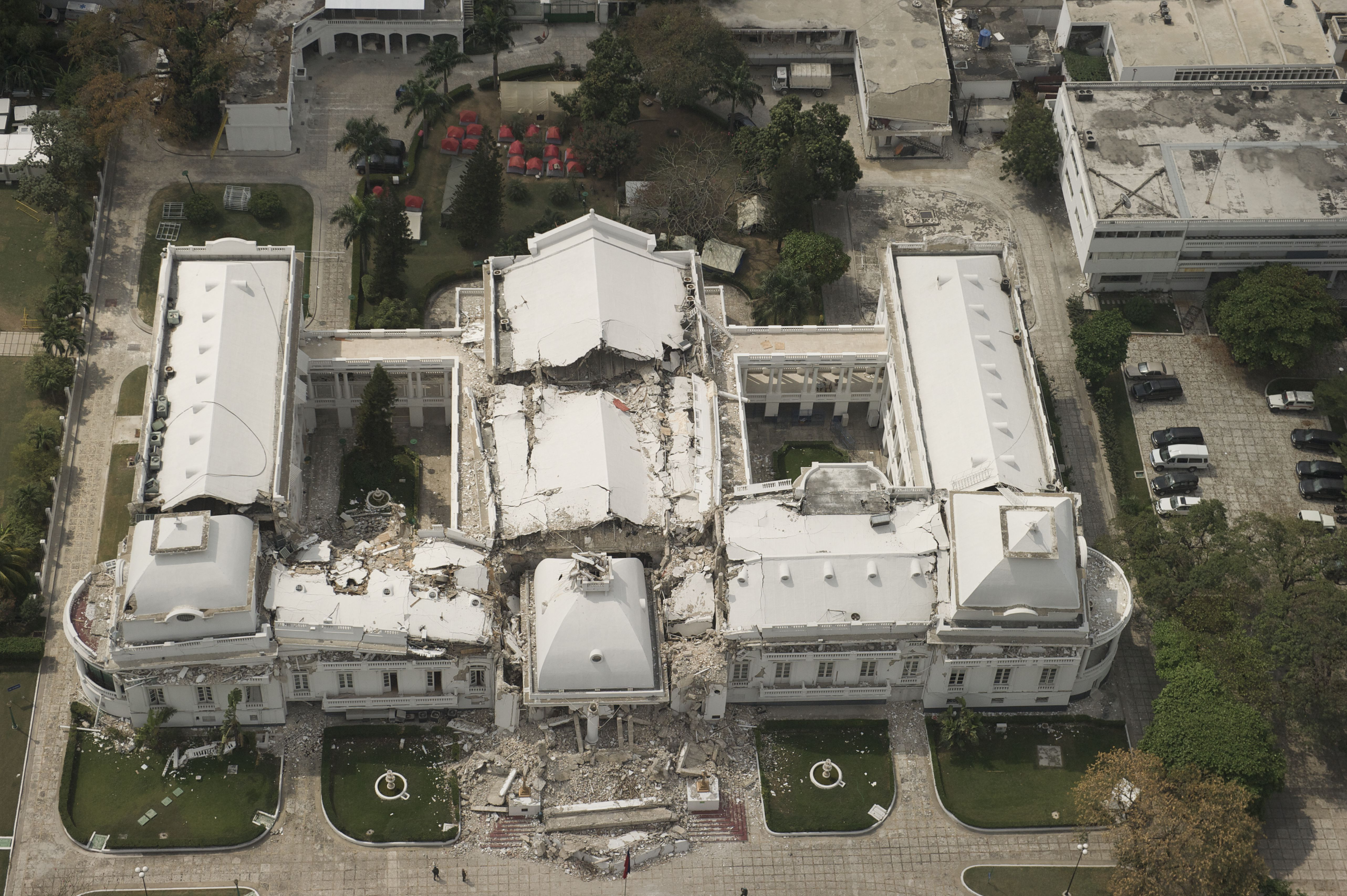 aerial view of presidential palace, roofs on all wings have colapsed onto spaces below