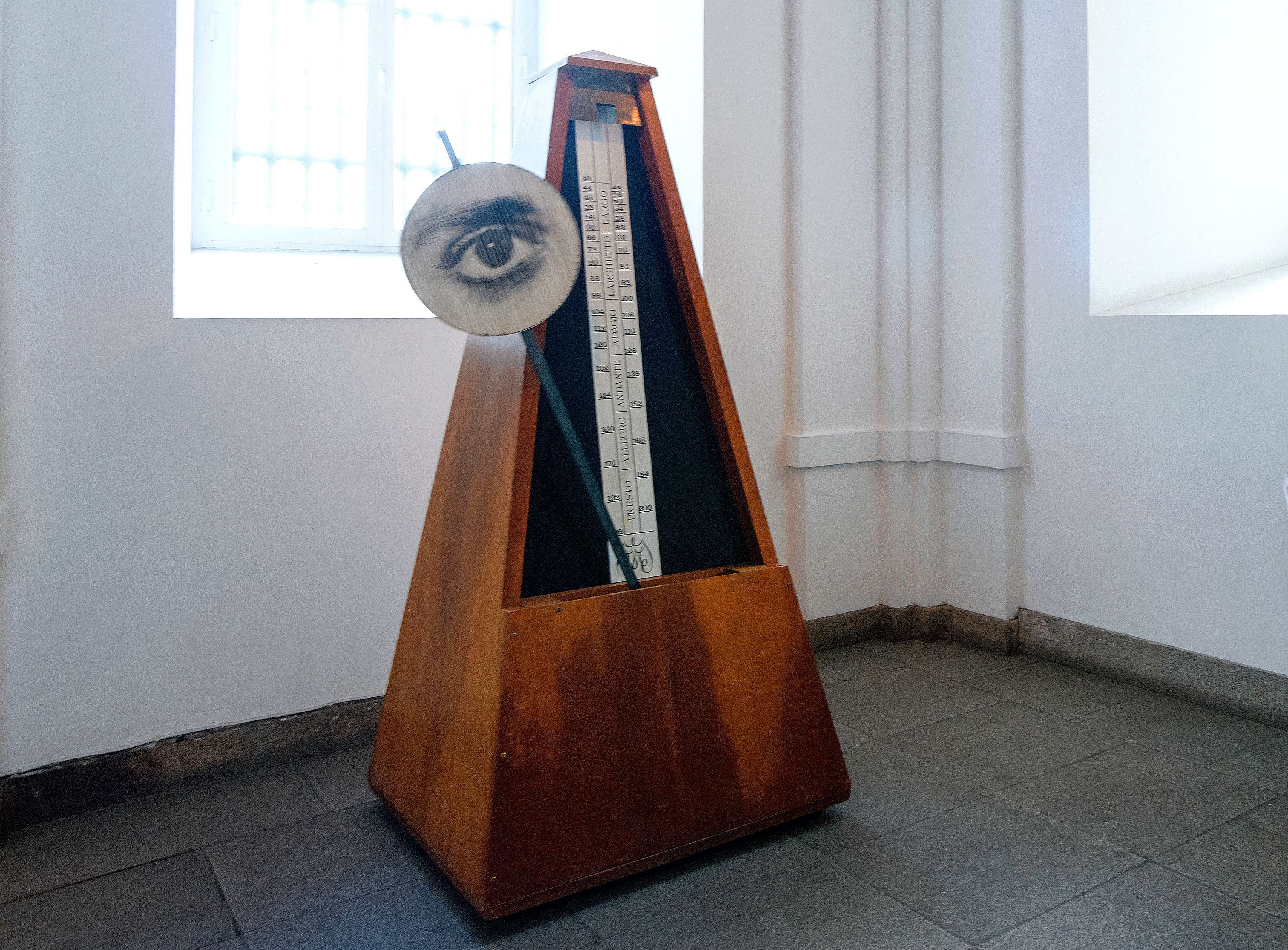 Metronome with a drawing of an eye attached